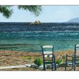 two chairs on koubara shore